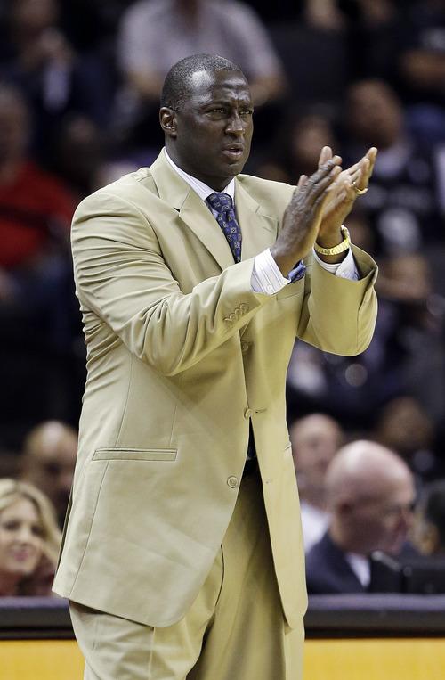 Utah Jazz coach Tyrone Corbin talks to his players during the fourth quarter of an NBA basketball game against the San Antonio Spurs, Saturday, Nov. 3, 2012, in San Antonio. (AP Photo/Eric Gay)