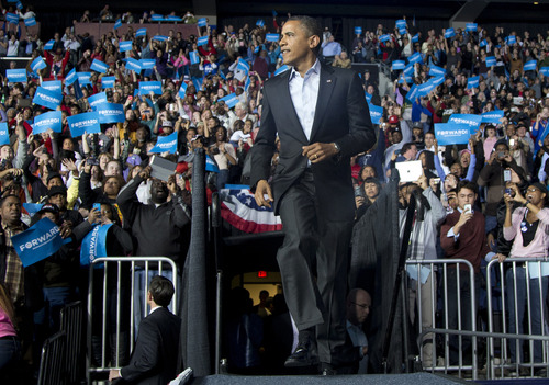 President Barack Obama takes to the stage as the crowd cheers to speak at a campaign event at Nationwide Arena, Monday, Nov. 5, 2012, in Columbus, Ohio.  (AP Photo/Carolyn Kaster)