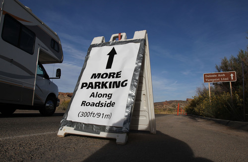 Francisco Kjolseth  |  The Salt Lake Tribune A sign leads the way to additional parking at the Delicate Arch parking area, one of the most popular areas in Arches National Park. The park's infrastructure was created based on an annual average visitation of 75,000. The park surpassed 1 million visitors in 2010 and is steadily climbing. Officials at Arches are considering options to reduce the number of cars in the park and a shuttle system is one option. However, it would be expensive and, if visitation numbers keep going up, it could soon be obsolete.