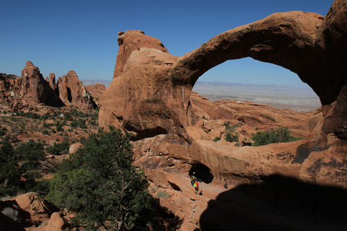 Francisco Kjolseth  |  The Salt Lake Tribune Visitors check out Double O Arch which can be accessed from the Devils Garden Trailhead located at the end of the road in Arches National Park.