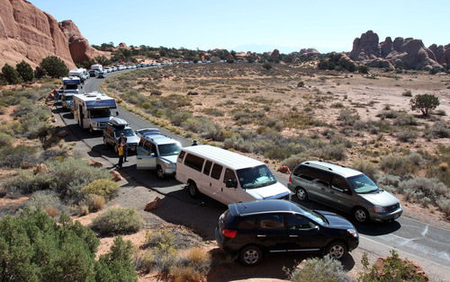 Francisco Kjolseth  |  The Salt Lake Tribune Parking spaces are at a premium during the peak season at the Devils Garden Trailhead in Arches National Park as visitors fill every available spot recently. The infrastructure of Arches National Park was created based on an annual average visitation of 75,000. The park surpassed 1 million visitors in 2010 and is steadily climbing. Officials at Arches are considering options to reduce the number of cars in the park and a shuttle system is one option. However, it would be expensive and, if visitation numbers keep going up, it could soon be obsolete.