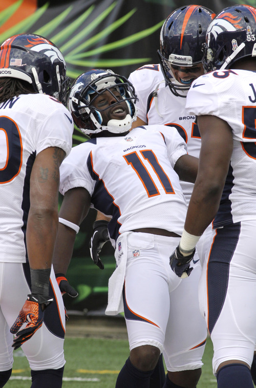 Denver Broncos wide receiver Trindon Holliday (11) celebrates after scoring on a 105-yard kickoff return in the second half of an NFL football game against the Denver Broncos, Sunday, Nov. 4, 2012, in Cincinnati. (AP Photo/Tom Uhlman)