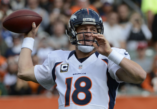 Denver Broncos quarterback Peyton Manning passes against the Cincinnati Bengals in the first half of an NFL football game, Sunday, Nov. 4, 2012, in Cincinnati. (AP Photo/Michael Keating)
