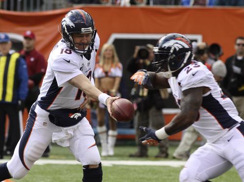 Denver Broncos quarterback Peyton Manning (18) hands off to running back Willis McGahee (23) in the first half of an NFL football game against the Cincinnati Bengals, Sunday, Nov. 4, 2012, in Cincinnati. (AP Photo/Tom Uhlman)