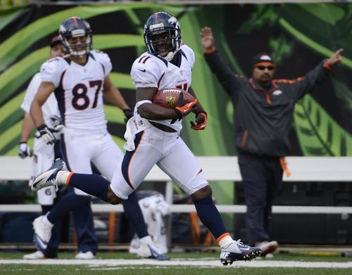 Denver Broncos wide receiver Trindon Holliday (11) scores on a 105 yard kickoff return to start the second half of an NFL football game against the Cincinnati Bengal, Sunday, Nov. 4, 2012, in Cincinnati. (AP Photo/Michael Keating)
