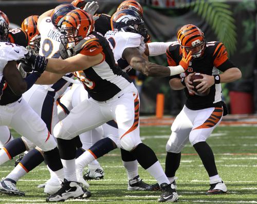 Cincinnati Bengals quarterback Andy Dalton, right, is sacked by Denver Broncos outside linebacker Von Miller in the first half of an NFL football game, Sunday, Nov. 4, 2012, in Cincinnati. (AP Photo/Tom Uhlman)