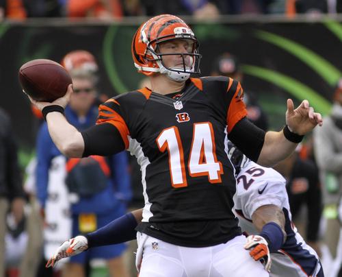 Cincinnati Bengals quarterback Andy Dalton (14) passes under pressure from Denver Broncos cornerback Chris Harris (25) in the first half of an NFL football game, Sunday, Nov. 4, 2012, in Cincinnati. (AP Photo/Tom Uhlman)