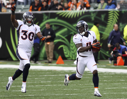 Denver Broncos wide receiver Trindon Holliday (11) returns a kickoff 105 yards for a touchdown to start the second half of an NFL football game against the Cincinnati Bengals, Sunday, Nov. 4, 2012, in Cincinnati. David Bruton (30) trails. (AP Photo/Tom Uhlman)