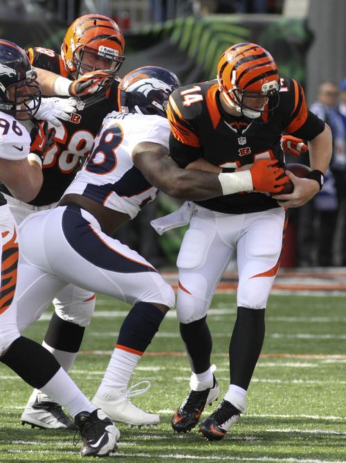 Cincinnati Bengals quarterback Andy Dalton (14) is sacked by Denver Broncos outside linebacker Von Miller (58) in the first half of an NFL football game, Sunday, Nov. 4, 2012, in Cincinnati. (AP Photo/Tom Uhlman)