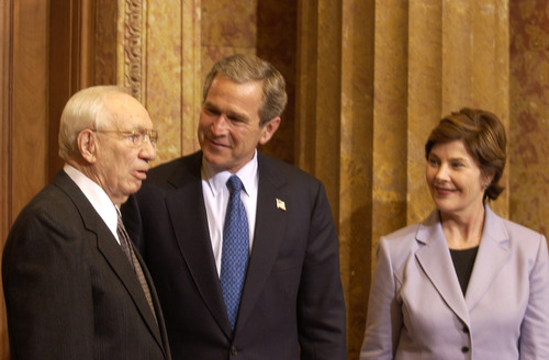 Tribune file photo  President George Bush and Laura Bush meet with LDS Church President Gordon B. Hinckley in Salt Lake City just before the Olympics in 2002.
