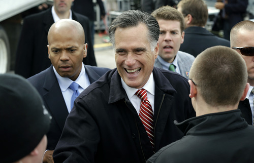 Republican presidential candidate, former Massachusetts Gov. Mitt Romney greets supporters after a speech on the economy, Friday, Oct. 26,2012, at a campaign stop at Kinzler Construction Services in Ames, Iowa. (AP Photo/Charlie Neibergall)