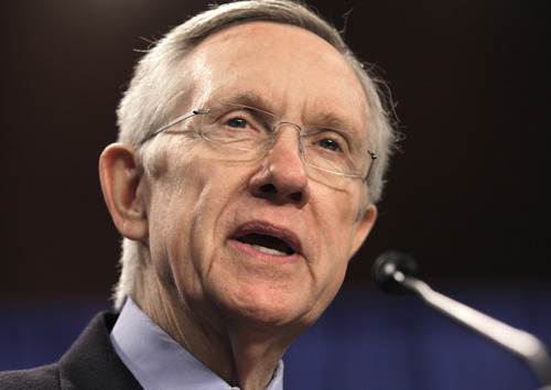 "Senate Majority Leader Harry Reid of Nev. speaks during a ""Back Off Social Security"" rally on Capitol Hill in Washington, Monday, March 28, 2011.  (AP Photo/J. Scott Applewhite)"