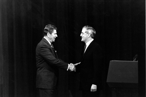 U.S. President Ronald Reagan, left, and Democratic candidate Walter Mondale shake hands at the start of the second round of the 1984 Presidential debate in Kansas City, Mo. on Sunday, Oct. 21, 1984. (AP Photo/Ron Edmonds)