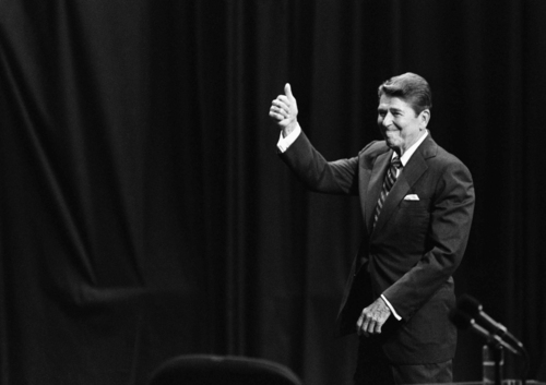 President Ronald Reagan gives a thumbs up sign towards the audience in the Kansas Municipal Auditorium Music Hall at the end of debate with Walter Mondale, Sunday, Oct. 22, 1984, Kansas City, Mo. (AP Photo/Ron Edmonds)