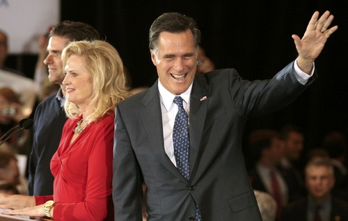 U.S. Republican presidential candidate and former Massachusetts Governor Mitt Romney arrives with his wife Ann (2nd L) and son Tag (L) to address supporters at his Michigan primary night rally in Novi, Michigan, February 28, 2012. REUTERS/Rebecca Cook