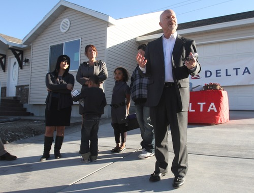 Rick Egan  | The Salt Lake Tribune   Mike Plaizier, president, board of directors, Salt Lake Valley Habitat for Humanity, talks about the new home in Taylorsville, as the Valenzuela family await the keys to their new home, Friday, November 2, 2012.