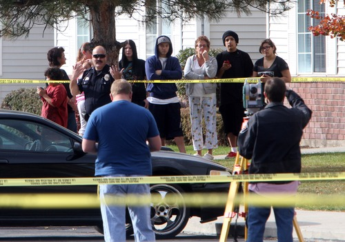 Rick Egan  | The Salt Lake Tribune   Apartment residents observe the investigation by West Valley police at the Lexington Park apartments in West Valley City, after a fatal shooting at the complex, Friday, November 2, 2012.