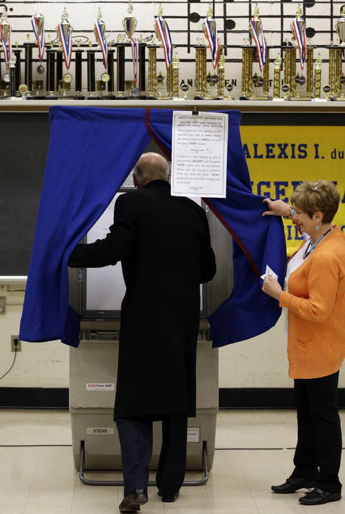 Vice President Joe Biden steps into a voting booth to cast his ballot at Alexis I. duPont High School, Tuesday, Nov. 6, 2012, in Greenville, Del. (AP Photo/Matt Rourke)