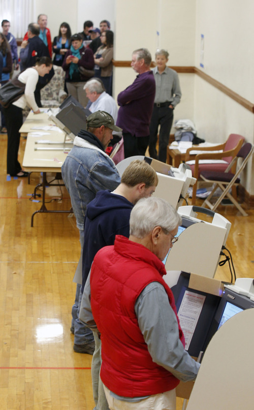 Al Hartmann  |  The Salt Lake Tribune Polls were busy Tuesday morning at Salt Lake Ensign LDS Church at 109 G St., which houses precincts SLC033 and SLC039.