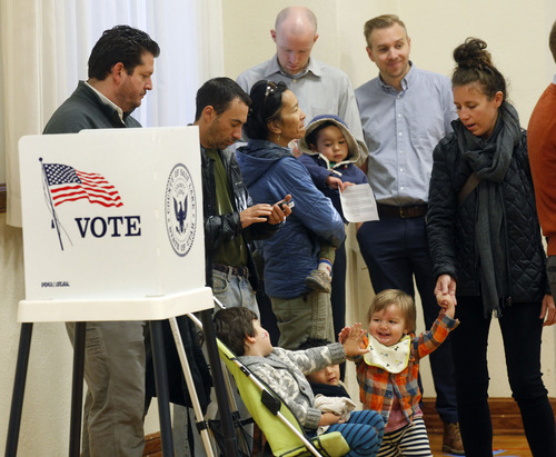 Al Hartmann  |  The Salt Lake Tribune Parents wait in line to vote Tuesday as their children socialize at Salt Lake Ensign LDS Church at 109 G St. in Salt Lake City. Voting was busy at this polling station.