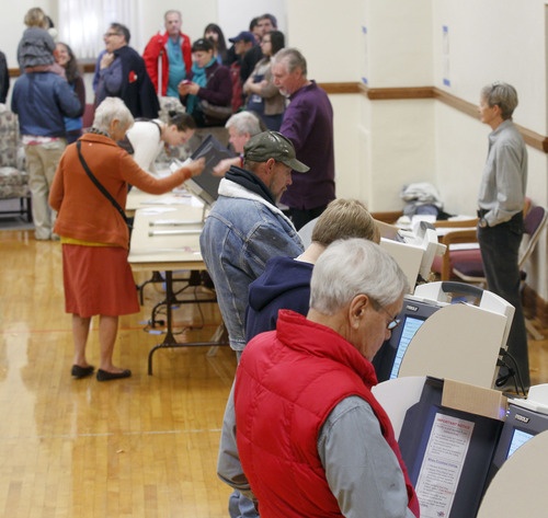 Al Hartmann  |  The Salt Lake Tribune Polls were busy Tuesday morning, Nov. 6 at Salt Lake Ensign LDS Church at 109 G St. in Salt Lake City, which houses precincts SLC033 and SLC039.