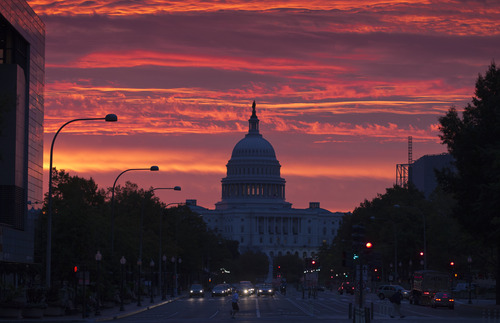 The Capitol dome is silhouetted as the sun rises in Washington, Monday, Oct. 15, 2012. (AP Photo/J. Scott Applewhite)