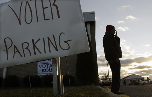Don Dunkelburger, of Seaside Heights, N.J., takes a smoke break outside a shelter and polling station at Toms River East High School Tuesday, Nov. 6, 2012. Dunkelburger, who lost his home and was staying in the shelter, said he was not clear on where he was supposed to vote Tuesday. (AP Photo/Mel Evans)