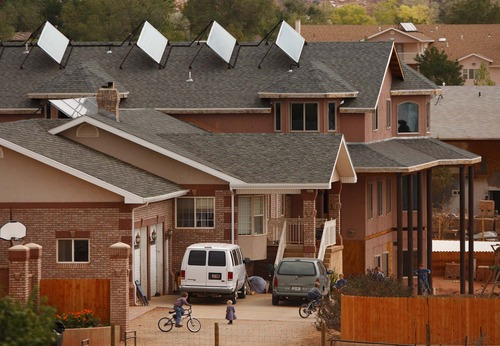 Children ride bikes behind the walls of their home in the twin cities of Hildale, Utah, and Colorado City, Ariz. Most of the property there is part of the state-controlled UEP trust, and is home to many members of Warren Jeffs' FLDS church.  Trent Nelson/The Salt Lake Tribune