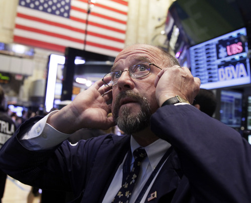 FILE - In this Thursday, Sept. 20, 2012 file photo, trader Frederick Reimer works on the floor of the New York Stock Exchange. Trading is expected to be light on Election Day Tuesday, Nov. 6, 2012, as many investors remain on the sidelines. (AP Photo/Richard Drew, File)