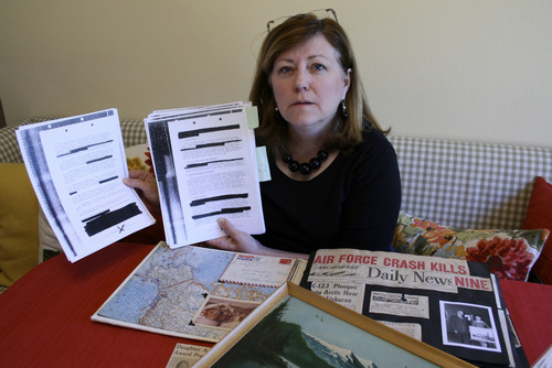 Courtesy photo Leslie Randle, of Orem, shows government documents she obtained concerning a 1966 plane crash in Alaska that killed her grandparents, Hugh and Elinor Yancey. She has investigated the crash through FOIA requests.