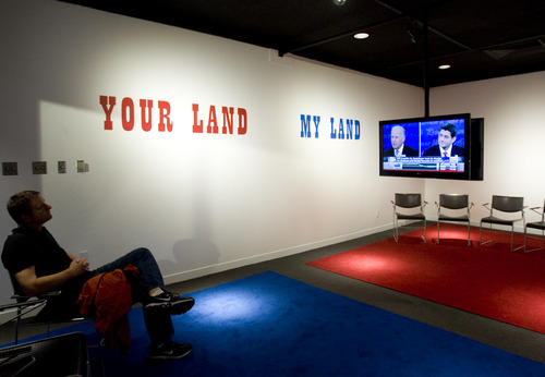 "Kim Raff | The Salt Lake Tribune People watch the screening of the vice-presidential debates in the Jonathan Horowitz ""Your Land / My Land: Election '12"" installation at the Utah Museum of Contemporary Art in Salt Lake City."