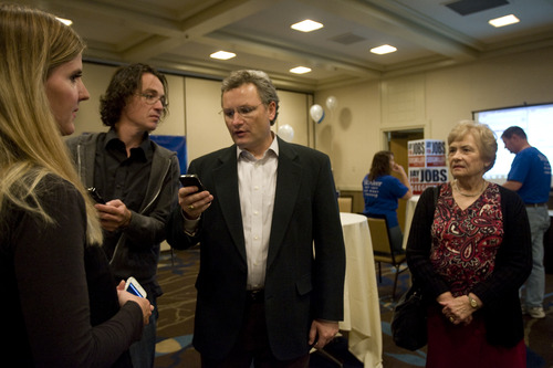 Kim Raff | The Salt Lake Tribune 3rd Congressional District candidate Soren Simonsen watches as early poll numbers come in at the Democrats' election night party at the Sheraton Hotel in Salt Lake City on Tuesday, Nov. 6, 2012.