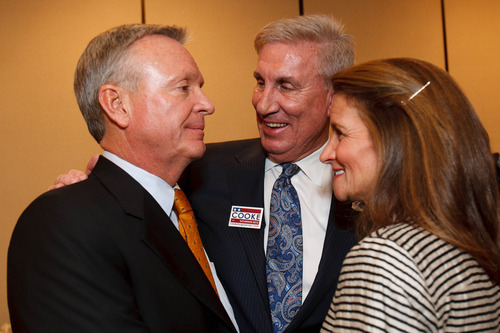 Trent Nelson  |  The Salt Lake Tribune Senate candidate Scott Howell, candidate for Utah Governor Peter Cooke, and Cooke's wife Heather Cooke share a moment at the Salt Lake Sheraton Hotel, Democratic headquarters on election night Tuesday, Nov. 6, 2012, in Salt Lake City.