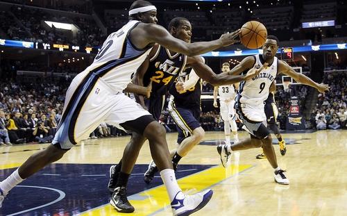 Memphis Grizzlies forward Zach Randolph, left, and guard Tony Allen (9) compete for a rebound against Utah Jazz forward Paul Millsap (24) in the second half of an NBA basketball game, Monday, Nov. 5, 2012, in Memphis, Tenn. The Grizzlies won 103-94. (AP Photo/Lance Murphey)