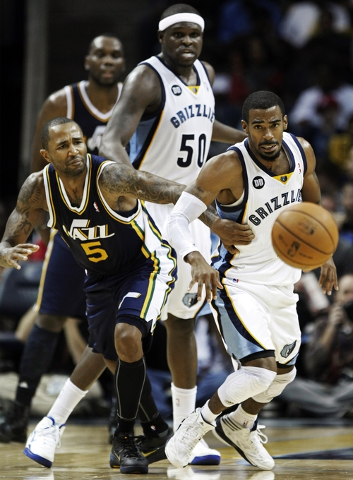 Utah Jazz guard Mo Williams (5) goes after a loose ball against Memphis Grizzlies guard Mike Conley in the second half of an NBA basketball game, Monday, Nov. 5, 2012, in Memphis, Tenn. The Grizzlies won 103-94. (AP Photo/Lance Murphey)
