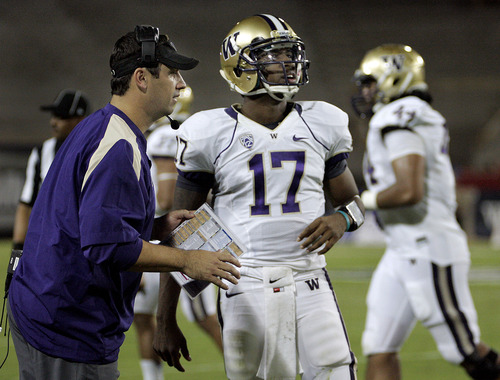 Washington head coach Steve Sarkisian, left, talks with his starting quarterback Keith Price (17) during the third quarter of an NCAA college football game against Arizona in Tucson, Ariz., Saturday, Oct. 20, 2012. (AP Photo/Wily Low)