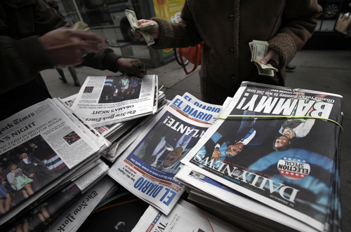 A news dealer sells copies of his papers on New York's Upper West Side,  Wednesday, Nov. 7, 2012. President Barack Obama won Ohio, Wisconsin, Virginia, Iowa, New Hampshire, Colorado and Nevada, seven of the nine battleground states. Romney captured only North Carolina. The final swing state ó Florida ó remained too close to call. (AP Photo/Richard Drew)