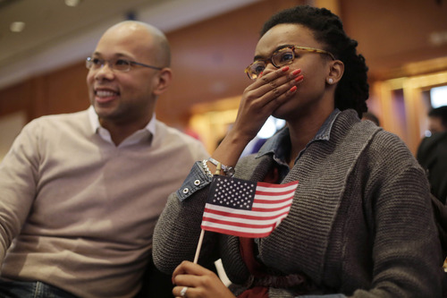 Aaliyah Bilal, of Ft. Washington, Maryland, right, and Brian Ingram, of Los Angels, CA, react as they watch live TV coverage showing the victory of Democratic presidential candidate President Barack Obama for his re-election Wednesday Nov. 7, 2012 in Shanghai, China. (AP Photo/Eugene Hoshiko)