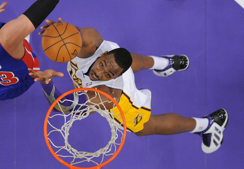 Los Angeles Lakers center Dwight Howard puts up a shot during the first half of their NBA basketball game against the Detroit Pistons, Sunday, Nov. 4, 2012, in Los Angeles. The Lakers won 108-79. (AP Photo/Mark J. Terrill)