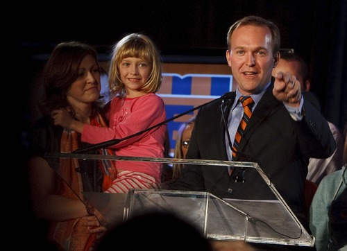 Leah Hogsten  |  The Salt Lake Tribune Salt Lake County Mayoral candidate Ben McAdams during his acceptance speech with his wife Julie, holding daughter Kate  at the Utah Democratic Party headquarters at Salt Lake Sheraton Hotel Tuesday, November 6, 2012.