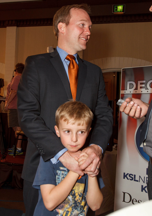 Trent Nelson  |  The Salt Lake Tribune Salt Lake County mayoral candidate Ben McAdams with his son James at the Salt Lake Sheraton Hotel, Democratic headquarters on election night Tuesday, Nov. 6, 2012, in Salt Lake City.