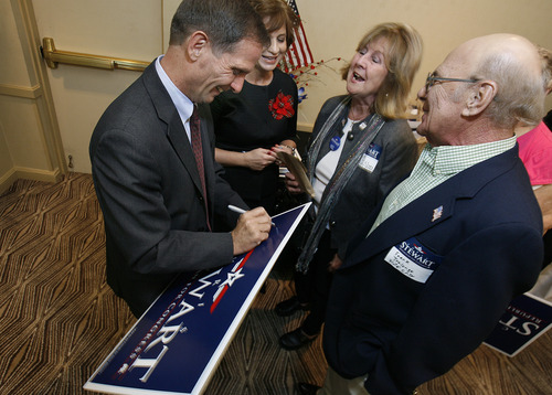 Scott Sommerdorf  |  The Salt Lake Tribune               2nd District Congressman-elect Chris Stewart is headed to Washington, D.C., for orientation sessions, along with the other 83 newly elected members. This Election Night photo shows Stewart and his wife, Evie, left, signing campaign signs for supporters.