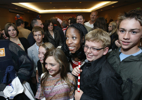 Scott Sommerdorf  |  The Salt Lake Tribune               4th Congressional candidate Mia Love poses for photos with supporters at the GOP headquarters at the Hilton Hotel in Salt Lake City, Tuesday, November 6, 2012.