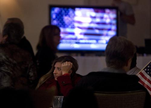 Scott Sommerdorf  |  The Salt Lake Tribune               Romney supporter Heather Bath waits for President Obama's acceptance speech at the GOP headquarters, Tuesday, November 6, 2012