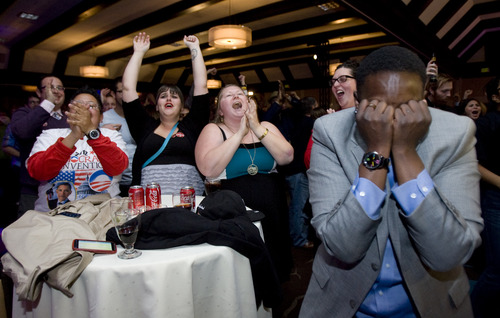 Kim Raff | The Salt Lake Tribune Obama supporters reacts to the projection of the re-election of President Obama at the Democrats' election night party at the Sheraton Hotel in Salt Lake City on Tuesday, Nov. 6, 2012.