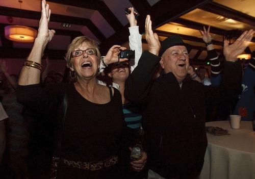 Leah Hogsten  |  The Salt Lake Tribune l-r Sandy Paulsen, Hasty Nazarinia and her father Seyedabbas Nazarinia celebrate President Barak Obama's re-election at the Utah Democratic Party headquarters at Salt Lake Sheraton Hotel Tuesday, November 6, 2012.