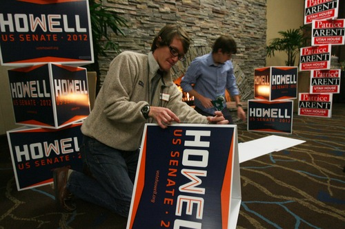 Kim Raff | The Salt Lake Tribune (left) Alex Peacock and Gary Ashcroft, campaign workers for Utah Senate candidate Scott Howell, set up displays for Howell at the Democrats' election night party at the Sheraton Hotel in Salt Lake City on Tuesday, Nov. 6, 2012.