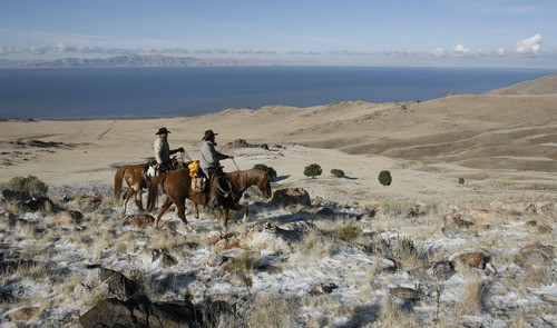 Francisco Kjolseth  |  The Salt Lake Tribune Rocky terrain greets riders on the west side of Antelope Island as they begin the bison push for the 26th annual bison roundup on Friday, October 26, 2012.