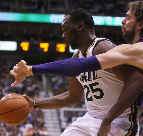 Kim Raff | The Salt Lake Tribune (left) Utah Jazz center Al Jefferson (25) defends the ball against (right) Los Angeles Lakers power forward Pau Gasol (16) during a game at EnergySolutions Arena in Salt Lake City, Utah on November 7, 2012.