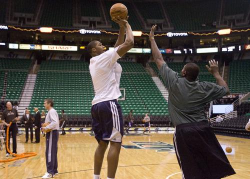 Kim Raff | The Salt Lake Tribune Utah Jazz power forward Derrick Favors (15) takes a jump shot during warmups at EnergySolutions Arena in Salt Lake City, Utah on November 7, 2012.